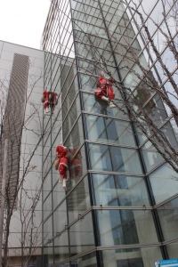 Climbing Santas outside the Richmond Hotel
