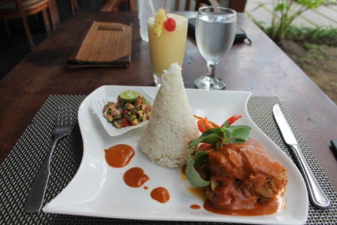 Ayam Taliwang. The steamed rice is served in a cone made of palm leaves.