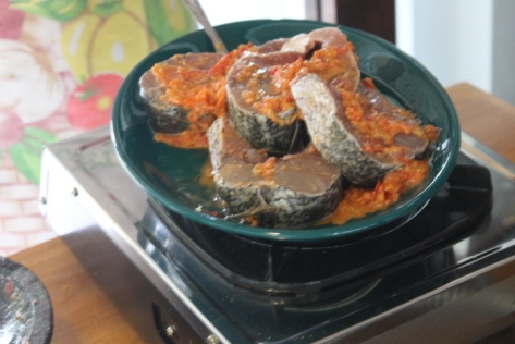 Marinating the barracuda before grilling.