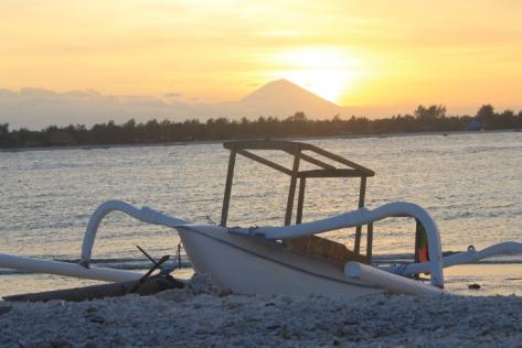 The sun setting behind Mount Ranjani.
