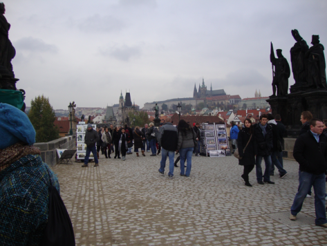 From the right side of the bridge, looking up at Prague Castle.