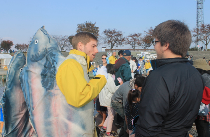One of the Oirase JETs served as the emcee (and human salmon hybrid) for the festival.  Here, he's interviewing a friend before the salmon catch..