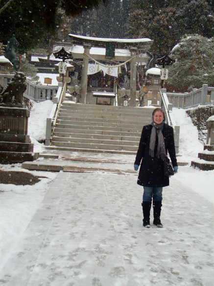 Freezing in front of a shrine.