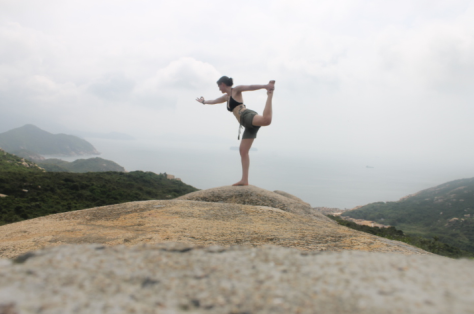"One of my favorite pictures of myself that I've ever taken. It was pretty serene...but I was also thinking to myself, ""Don't extend dancer pose to far, because if you fall off of this rock, you will break your neck."""
