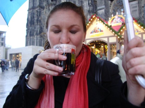 Sampling the hot mulled wine in Cologne's biggest Christmas market.