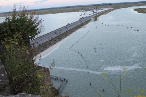 The footbridge in the lower left corner becomes covered by the rising tide.