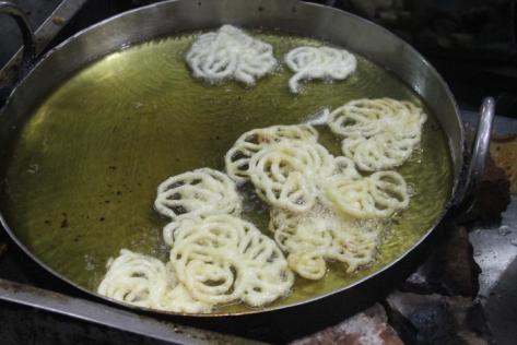 Jalebi, happily frying away.