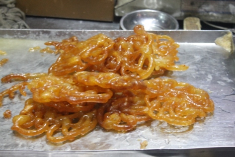Dessert, round two: jalebi. These may look like the cousins of American funnel cakes, but they're so much better. Jalebi are pretty simple: wheat flour batter deep fried and then soaked in sugar syrup. I had them fresh out of the syrup. They were still slightly warm in the center, but the outside was beginning to crystallize, so when I bit into them, the still slightly molten, gooey center melted in my mouth. Pretty sure I moaned. Couldn't help myself.