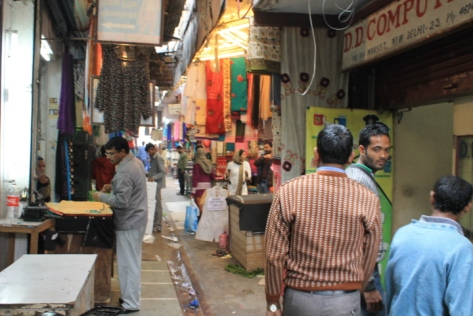 The narrow aisles between the stalls of INA Market.
