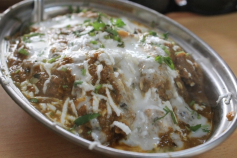 Mutton masala, topped with shredded paneer (curd cheese).