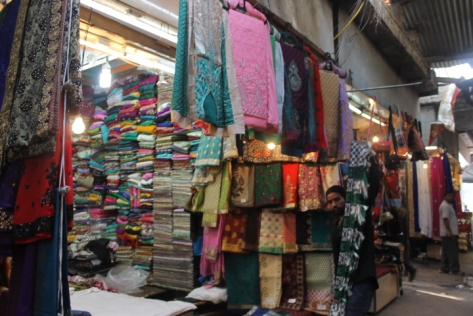 A fabric stall inside INA Market.