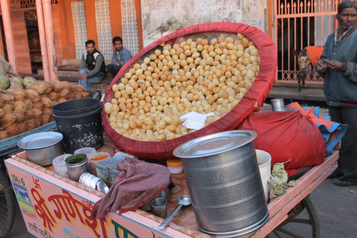 A street cart selling pani puri on the streets of Jaipur.