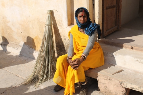 """I loved the way this woman's brilliant saffron sari contrasted with her blue scarf and red bindi. Most Indians are willing to let you take their picture, so long as you ask beforehand and hand over 20-50 rupees as a """"thank you"""" afterward."""