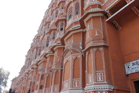 A closer shot of Hawa Mahal and its angled wall.