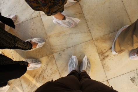 Slippered feet for walking on the marble floors of the Taj.