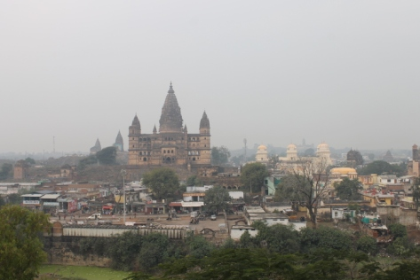 The larger temple on the left is Chaturbhuj Temple; the white temple is Ram Raja.