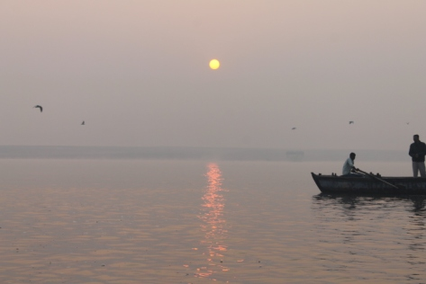 The burnished sun reflecting off of the Ganges.