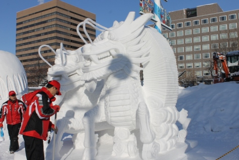 The sculpture from Hong Kong. Every morning, the sculptors brush off any snow that fell the night before to ensure that the sculpture looks clean and fresh.