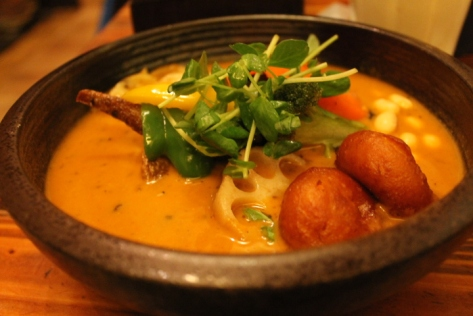 A steaming hot bowl of soup curry.
