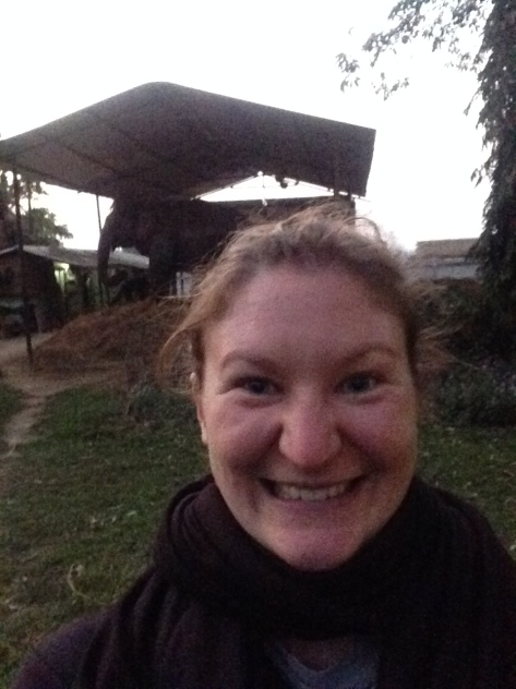 """This is my """"I don't care how goofy/crazed I look, there's an ELEPHANT behind me!"""" smile."""