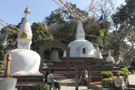The entrance to the complex, with smaller white stupa.