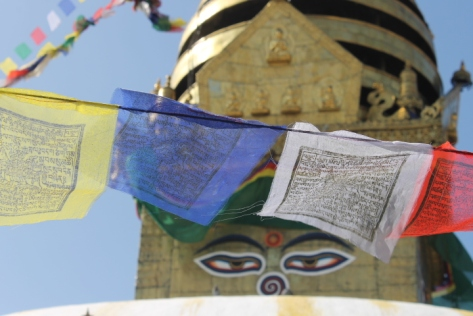 All-knowing eyes and prayer flags