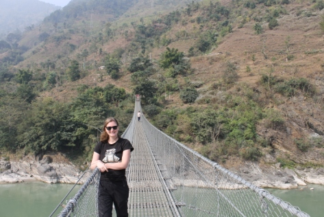On one of the suspension bridges that span the river.