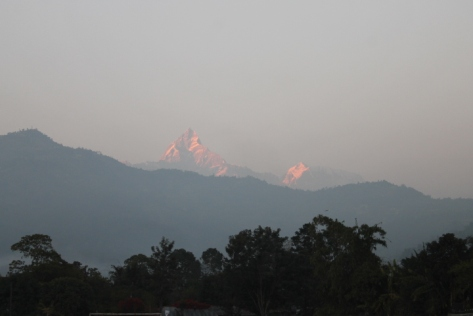 """The mountain to the right is Machhapuchchhre. (And no, that's not a typo.) It translates as """"Fish Tail"""" into English, and it's named for its distinctive twin summit peaks. Unfortunately, they can't be seen from the angle."""