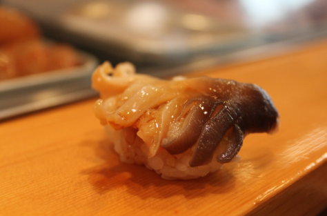 This was one of my favorites pieces! 赤貝 (akagai) is a clam with a slightly crunchy texture. The flavor is fantastic: it starts off mild, but as you chew, a sweeter taste blossoms. It provides good entertainment value, too. This guy was still alive when the chef set him in front of me, and he gave a last few valiant wiggles he became breakfast.