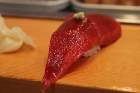 Blood red マグロ (maguro, tuna), topped with just a tiny dot of wasabi.