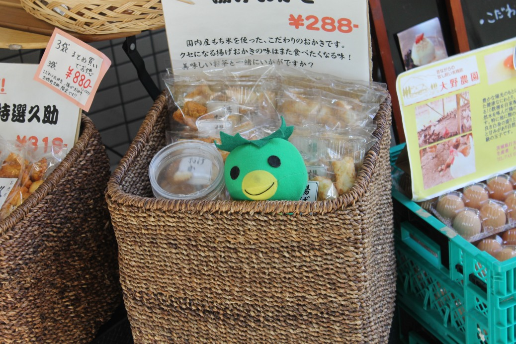 A kappa peeking out from one of the shops.
