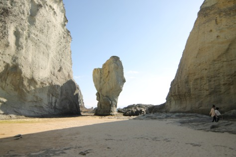 A rock formation on the beach