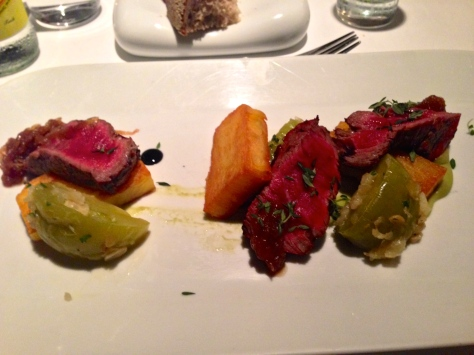 "Grilled beef tenderloin, and caramelized onion, green tomato, fava beans, with a reduced ""Çalkarası"" wine sauce."