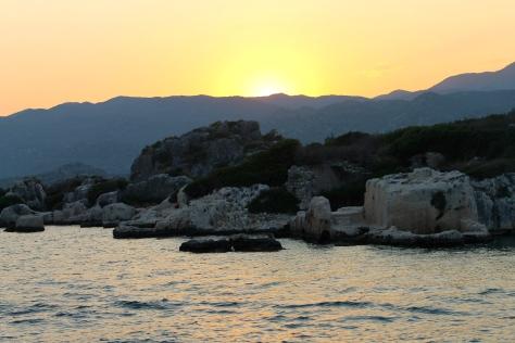 The sun setting behind Ucagiz.