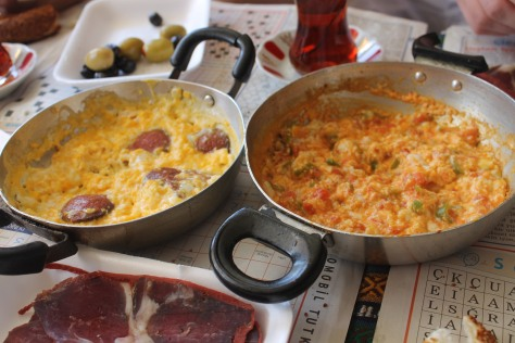 Scrambled eggs, cured meat, and olives are standard Turkish breakfast fare.