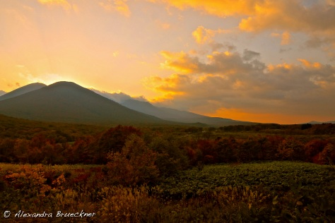 The sun setting behind Mount Hakkoda.